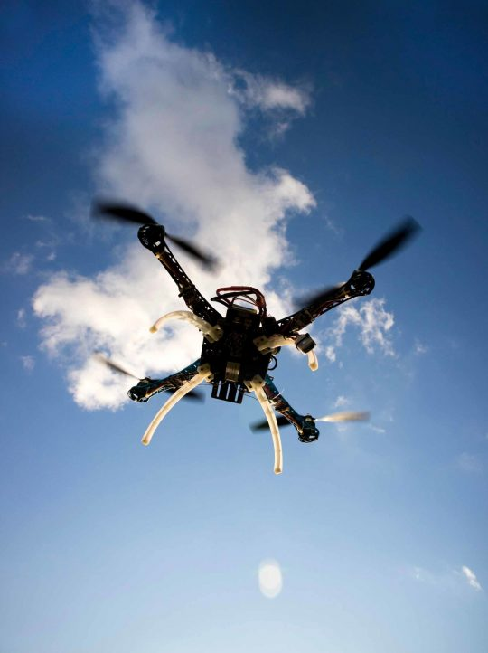 drone-in-flight-with-cloudy-sky-PTCUKNJ-scaled.jpg